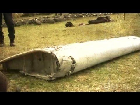 Crews examining debris for links to missing  MH370 plane