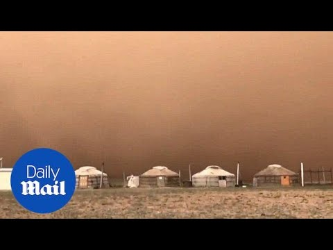 Sandstorm transforms city and turns the sky orange - Daily Mail