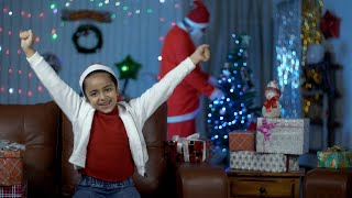 Pretty Indian girl is really excited after seeing Santa at her home on Christmas Eve