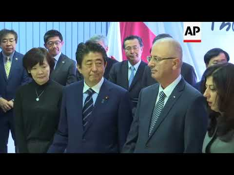 Japanese PM Abe visits West Bank, meets Palestinian counterpart