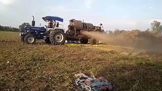 farmtrac 60 epi ट्रैक्टर थ्रेसर पर