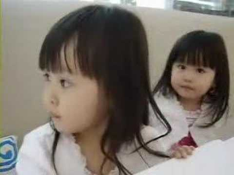 Young asian twins