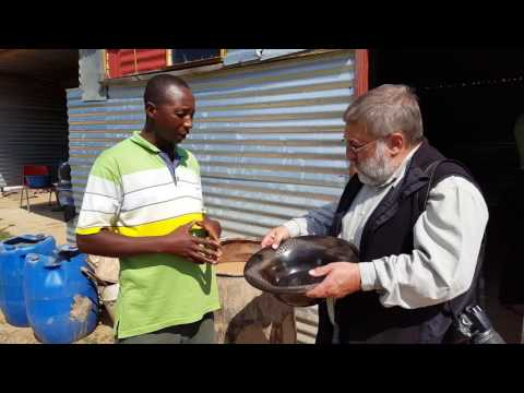Tefo Emandulo (near Witsieshoek) explaining to Harold Goodwin about pottery