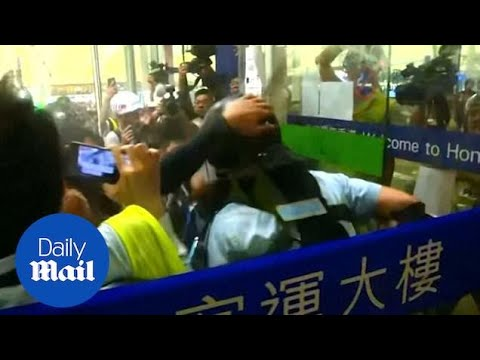 Protester and police violently clash outside Hong Kong airport
