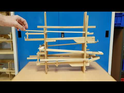 Education. Wooden Marble Run Made by Children.