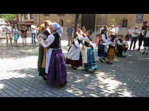 Girls dancing Asturian folk dance wearing traditional outfits