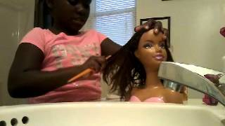 Doing doll baby hair