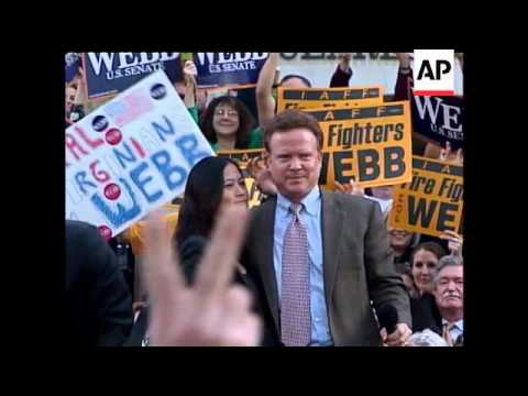 Virginia Senator Jim Webb defends a senior aide who was arrested after trying to carry a loaded pist