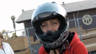 Hot girl does motorcycle stunt