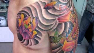 koi y flor de loto tattoo  ETERNAL INK manizales estudio de tatuajes