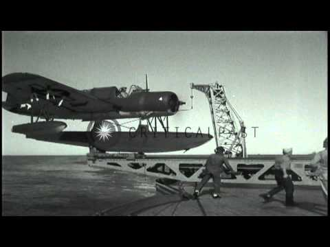 American Float Plane OS2U Catapulted From Battleship And Bombardment At San Ferna...HD Stock Footage
