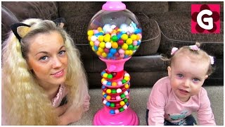 Gaby and Mommy playing with pink Giant Gumball Machine