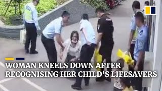 Chinese woman kneels down after recognising men who saved her child's life