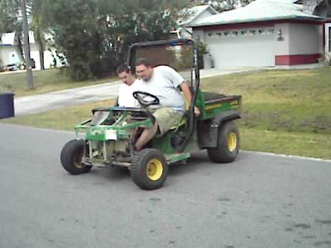 Modified John Deere Gator 4X2 doing dohnuts  YouTube