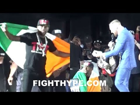 CONOR MCGREGOR SNATCHES FLOYD MAYWEATHER'S MONEY BACKPACK AFTER MAYWEATHER WEARS IRISH FLAG