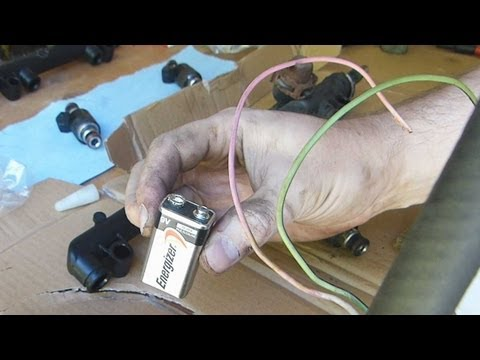 Improvised fuel injector cleaning with a battery and... a bullet.