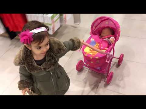 Thumbnail: Little Girl Pushing Pink Stroller in Shopping Centre