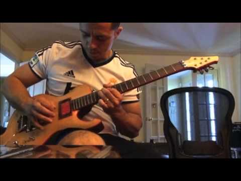 Santiago Plays The Red Bound Griffon Electric Guitar