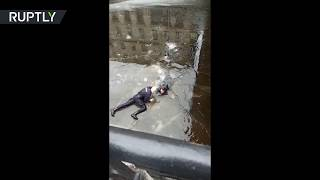 St. Petersburg mood: Russian cop saves man who suddenly jumped in the canal