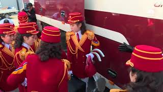North Korean cheerleaders arrive at Olympic Village