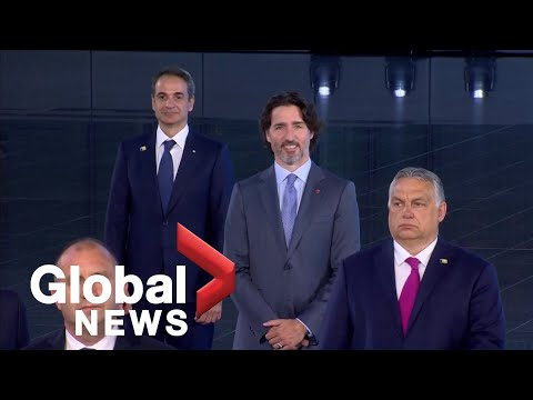 """NATO leaders pose for """"family photo"""" at summit in Brussels"""
