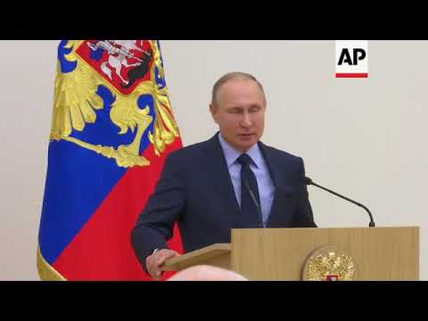 Putin tells Olympic athletes to forget about doping scandal during games