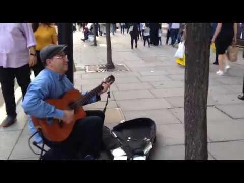 Guitar music street artist oxford street London, UK