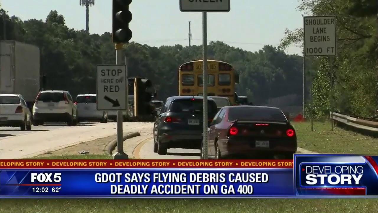 Woman killed when debris hits car on GA 400