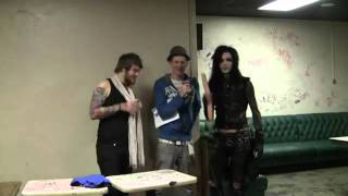 Andy Biersack and Danny Worsnop playing with a dildo