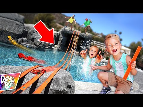 Giant Hot Wheels Swimming Pool Race Track! 💥 (WHO WINS?!)