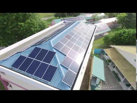 Solar panels adorn rooftops at Addu High School in the Maldives
