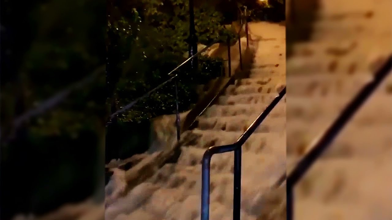 Slow-moving storm Henri drenches Northeast US
