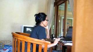 Tante Dewi H working at the Villa, Bali