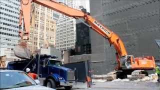 Hitachi ZX800 Triple Boom Excavator Loading Kenworth T800 Dump Truck