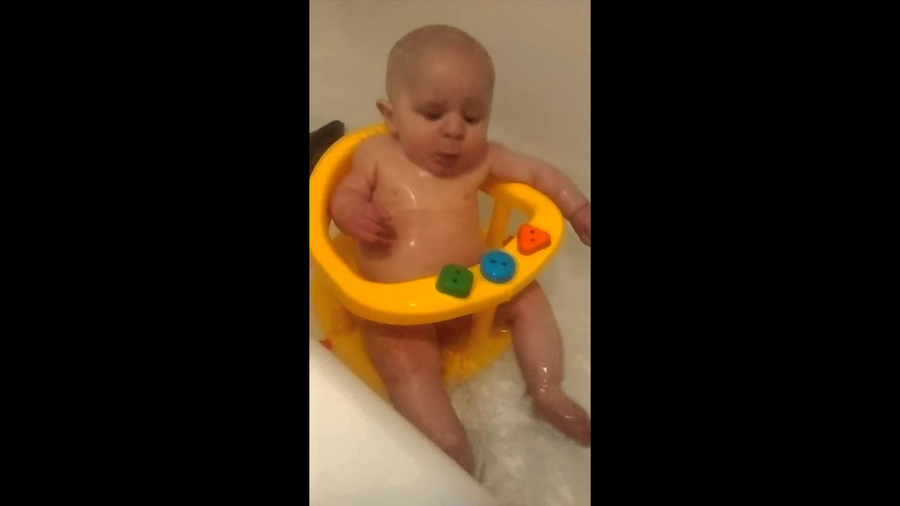 Oliver in the bath ring for the first time - YouTube