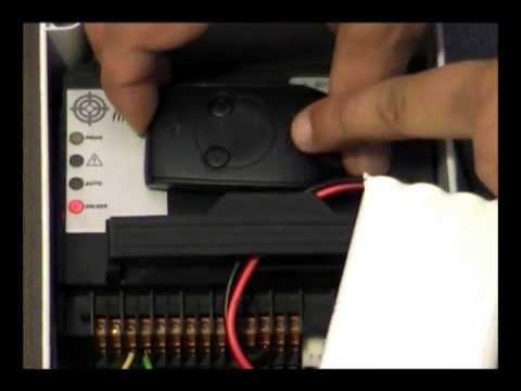 Comment ajouter une t l commande sur un moteur de portail for Moteur somfy porte de garage notice