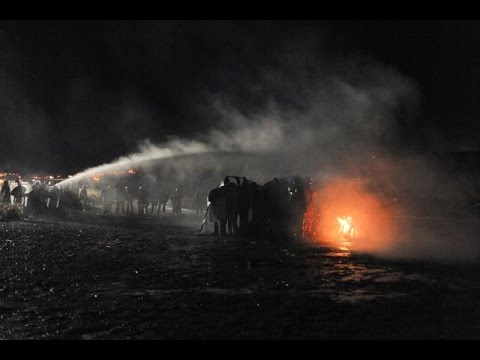 Anti-Pipeline Protesters Sprayed With Water Cannon In Freezing Weather