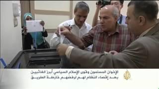 المصريون يدلون بأصواتهم في أول انتخابات برلمانية بعد الانقلاب