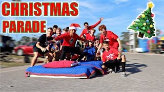 BED SURFING IN CHRISTMAS PARADE WITH FANS!