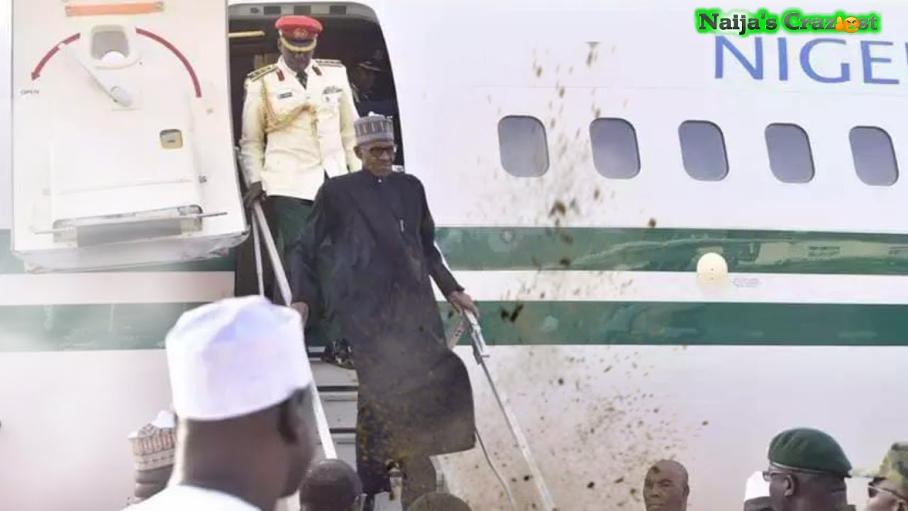Download Frail Buhari Nearly Blown Away By Wind on Return From UK Medical Sick Trip