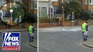 Ice block falls from sky, nearly striking shocked passersby