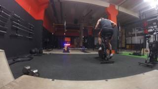 100 cal asaul every min 5 thrusters 135lb, start on bike