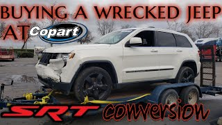 REBUILDING a wrecked jeep grand Cherokee from copart + jeep srt conversion