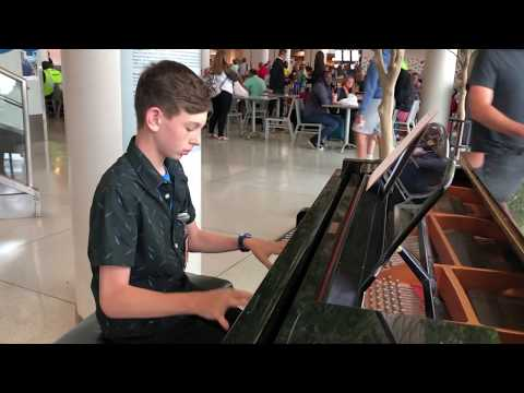 The Entertainer performed by 13 year - old volunteer pianist