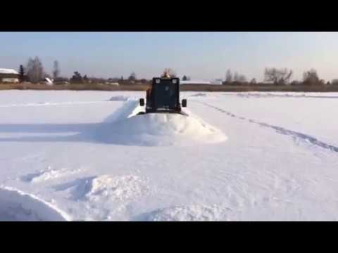 минипогрузчик JCB Robot уборка снега