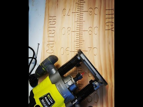White wash wooden growth chart using a plunge router