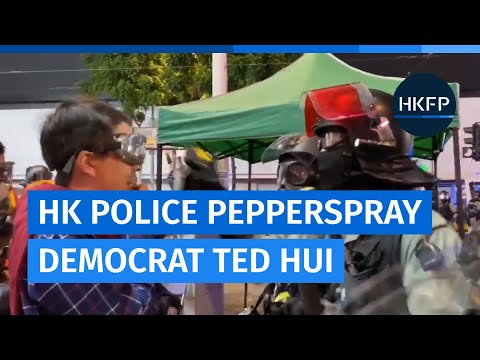 Hong Kong police pepperspray pro-democracy lawmaker Ted Hui at protest