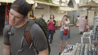 There she is! | Colleague in background of The Amazing Race episode