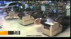 On tape: car plows into supermarket