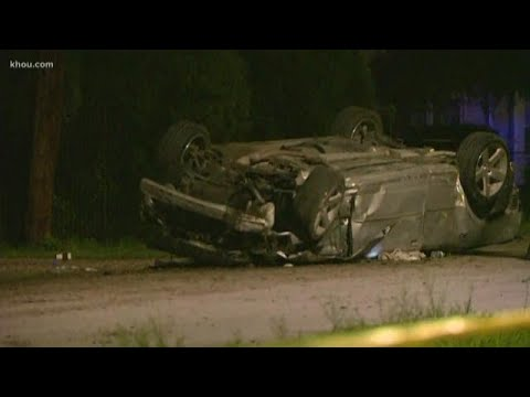 Two dead in rollover crash in northeast Houston, third person trapped